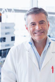 Portrait of a smiling scientist wearing lab coat