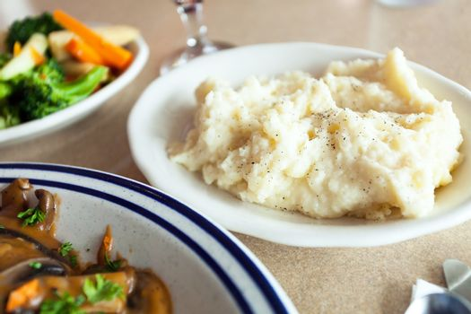 Mashed potato side dish with a shallow depth of field.