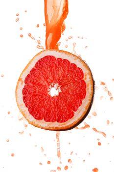 Grapefruit juice splashing