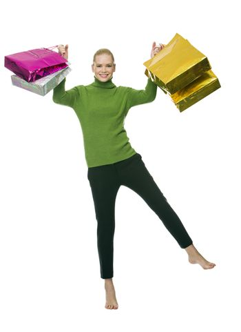 blonde smiling woman with gift bags jumping