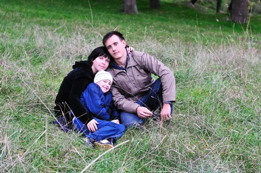 happy family in forest in early autumn