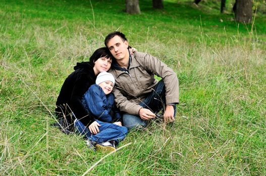 happy family  in the forest during early autumn