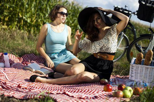 Girls on picnic, summer free time spending