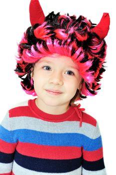 Portrait of funny little girl wearing devil's horns