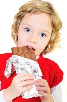 little girl eating big chocolate bar