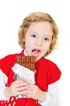 little girl want to bite big chocolate bar