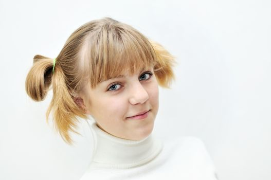 portrait of teen blonde girl with funny hairstyle