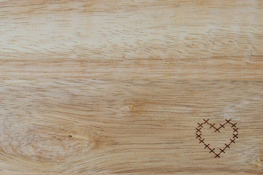 wooden background with heart on it