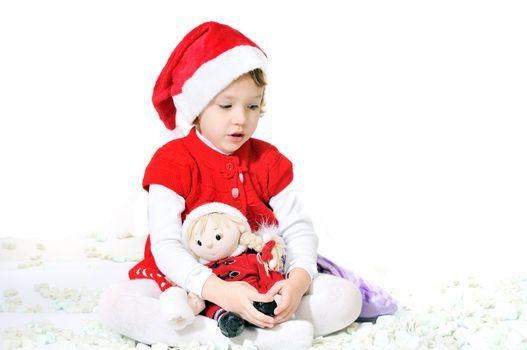 little santa helper sitting with doll