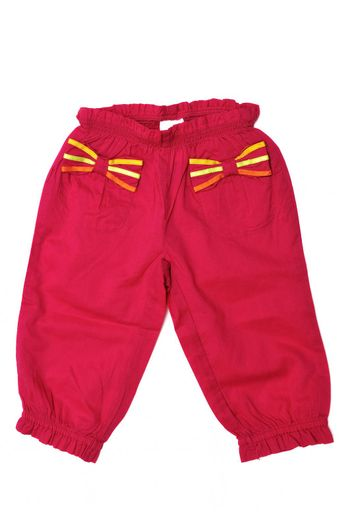 red baby girl's pants on over the white