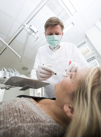 Dentist in action from low angle view