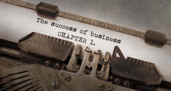 Vintage typewriter, old rusty and used, The succes of business, chapter 1