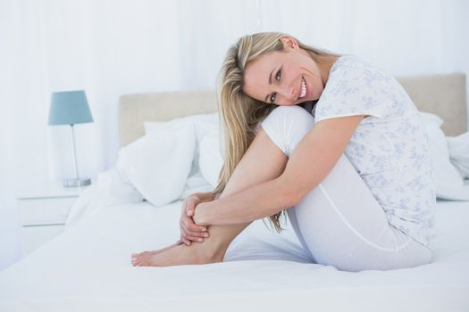 Content blonde sitting in her bed