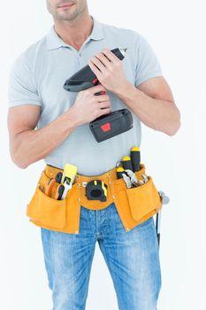 Technician holding handheld drill