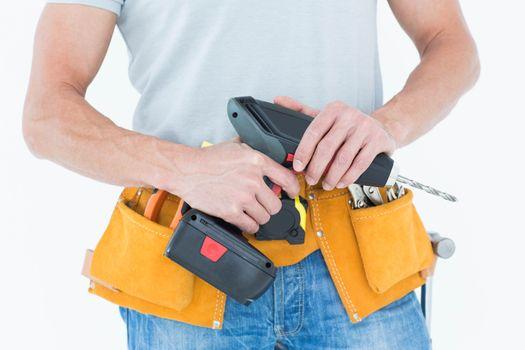 Repairman holding handheld drill