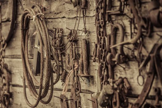 Wall Filled with Old Rusty Tools Hanging on the wall