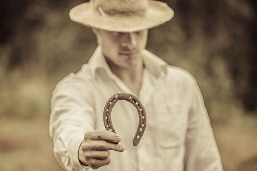 Lucky Farmer Holding a Horseshoe in his right hand