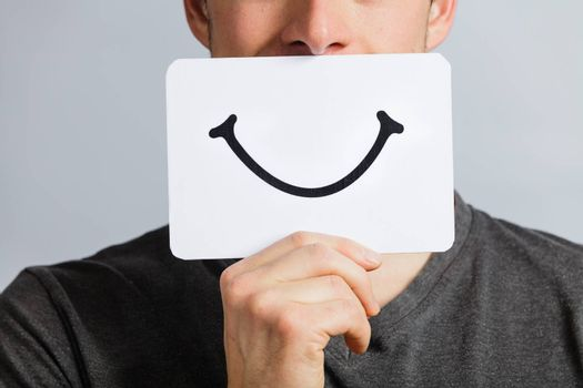 Happy Portrait of a Man Holding a Smiling Mood Board