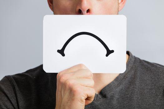 Unhappy Portrait of a Man Holding a Sad Mood Board