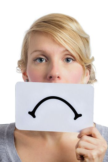 Unhappy Portrait of a Woman Holding a Sad Mood Board Isolated on white Background