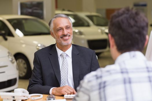 Salesman speaking with a client