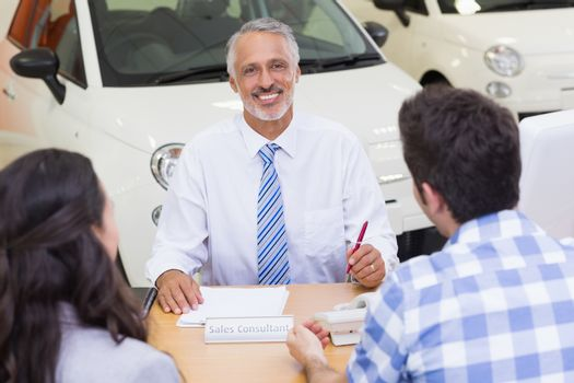 Salesman speaking with his clients