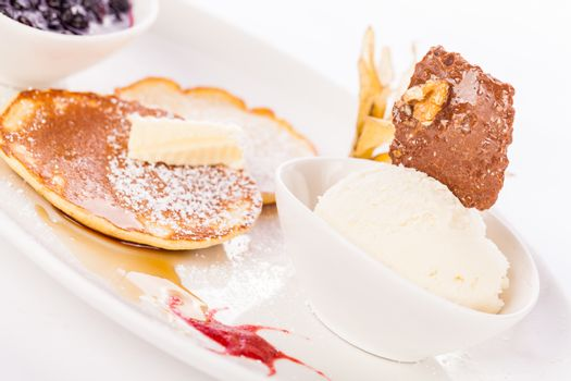 tasty sweet pancakes with vanilla icecream and topping