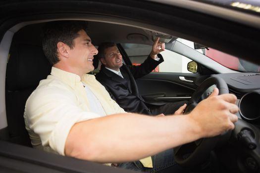 Man pointing a car interior