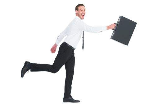 Happy businessman leaping with his briefcase