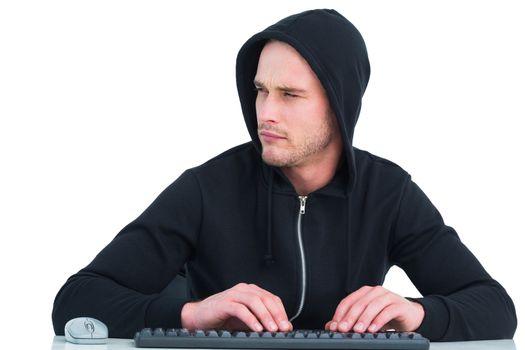 Stern hacker typing on keyboard