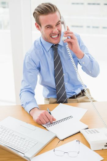 Frustrated businessman on the phone