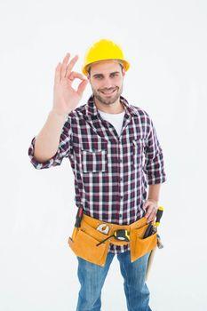 Handyman gesturing okay