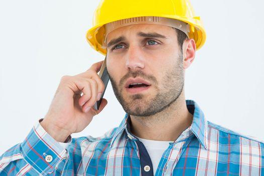 Carpenter using cellphone