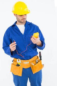 Repairman examining multimeter