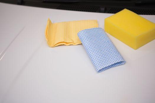 Sponge and rag on a car