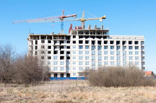 Construction site with cranes on sky background. Kaliningrad. Russia.