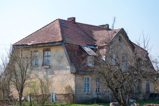 Old ruined, German House in the village. Spring season.