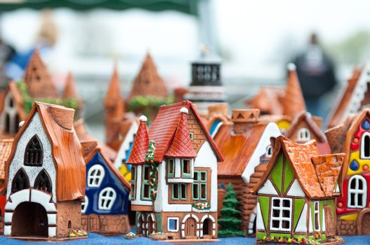 Many ceramic toys for children. Souvenirs. Building houses and lighthouses.