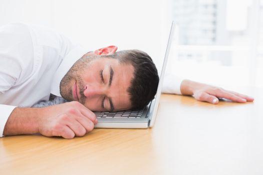 Businessman sleeping in his computer