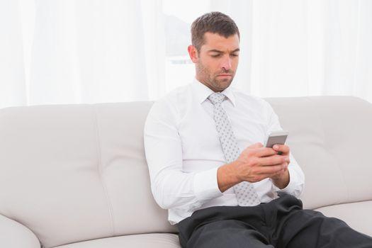 Businessman sending a his text i