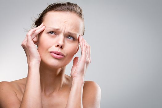 Gorgeous young woman with severe headache/migraine