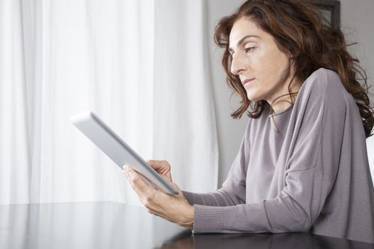 woman with tablet indoor