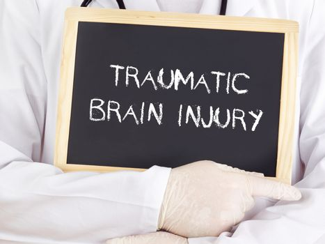 Doctor shows information: traumatic brain injury