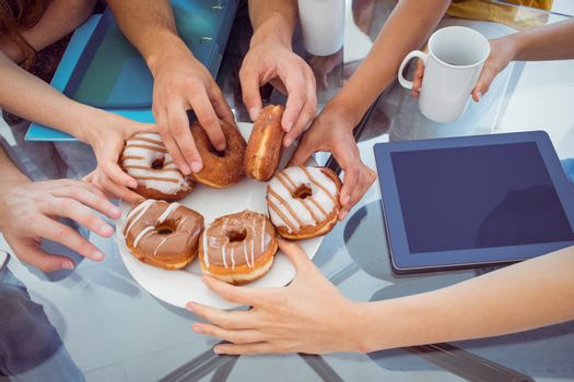 Fashion students eating doughnuts at the college