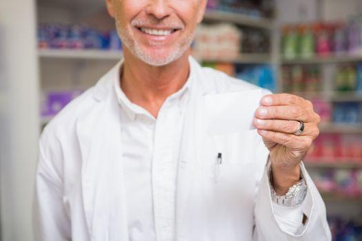 Senior pharmacist holding calling card