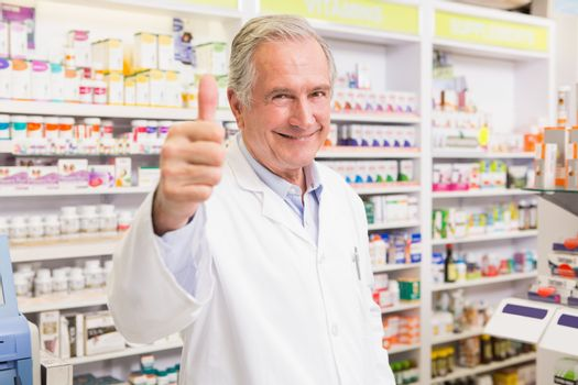 Positive pharmacist with thumb up