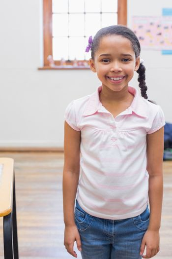 Smiling pupil in classroom