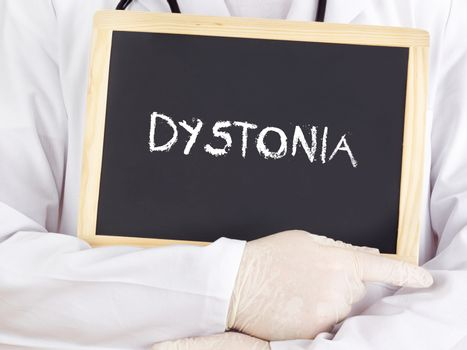 Doctor shows information on blackboard: Dystonia