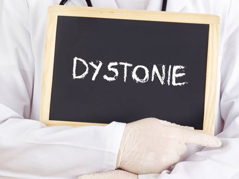 Doctor shows information on blackboard: Dystonia in german