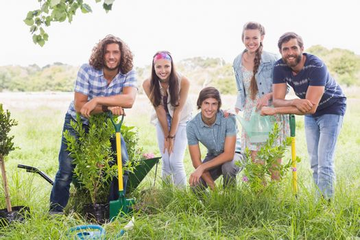 Happy friends gardening for the community
